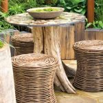 traditional look garden furniture idea on wooden deck patio with rattan ottoma and round table with log beam