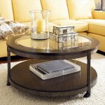 traditional round coffee tables with storage made of wood with storage beneath decorated in modern living room ideas with yellow sectional sofa and cozy rug