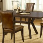 traditional small rectangular dining table made of mahogany wood and comfy chairs with leather accent and soft rug on hardwood floor