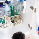 underneath-bathroom-sink-organization-with-tension-rod-for-spray-and-bins-under-the-rod-for-other-cleaners