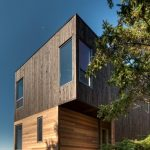 Unique Blocked Conctemporary Wooden House Design With Glass Window And Contrast Wooden Siding