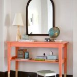 unique wooden console table for vanity with coral color with wall mirror and bench and wooden floor