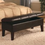 upholstered bench with storage made of leather and wooden leg plus furry rug and comfy bedding set