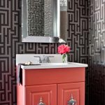 vintage bathroom vanity idea with coral color and framed wall mirror and wallpaper