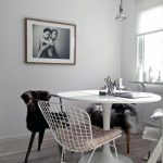 vintage dining space idea with ikea chair desgn and white wire chair and black and traditional pendant and white washed wooden floor
