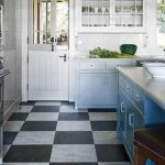 vintage kitchen design with white cainetry and wooden door and open plan and wooden stool and plaid black and white kitchen flooring idea