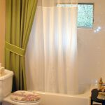 white shower curtain liner near green curtain and glass window and white bathtub and white water closet with flowers picture
