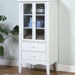 white storage cabinet with glass doors for bathroom in vintage style and completed with two drawers