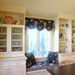 window seats with storage in dining room in blue and florals pattern plus adorned with window valances