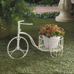 wonderful bycicle indoor plant wrought iron stand idea with white color with pink flower on green meadow
