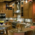 wonderful classic luxurious kitchen idea with bar with river gold granite idea with lighting and island and stools and chandelier