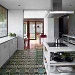 wonderful tropical kitchen idea with white cabinetry and white island andbulb green kitchen flooring idea and open plan