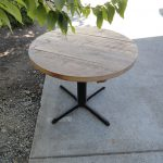 40 round dining table with black base for outdoor