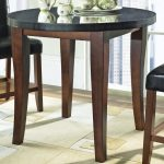 40 round dining table with granite top and wooden legs and black leather chairs plus patterned rug