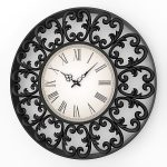 A fancy wall clock with crafted wrought iron frame