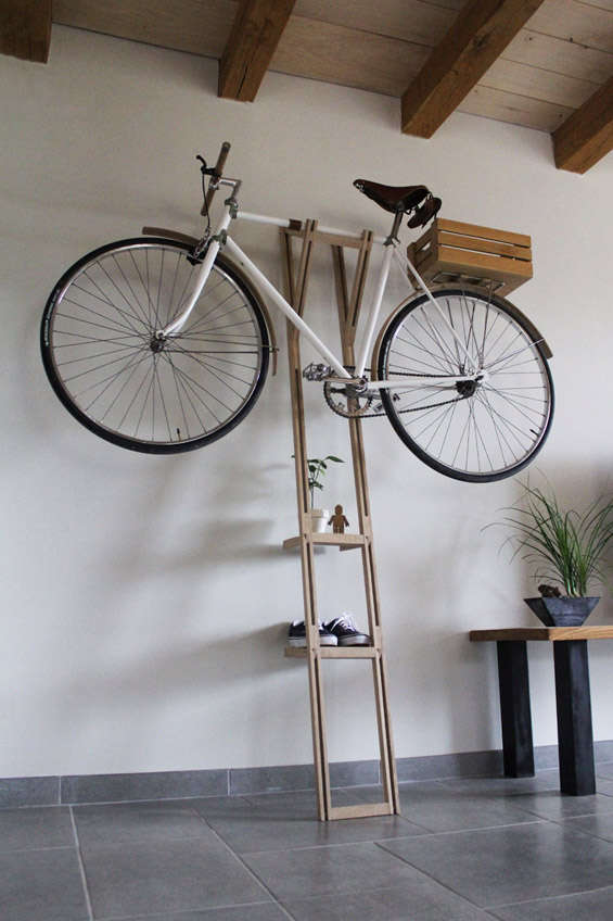 A Tinny Leaning Ladder Wood Rack With Bike On Its Top
