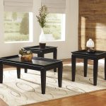 Black Wooden Cocktail Table Set With White Rug And Shades On Window