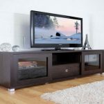 Black finished wooden media cabinet with glass door  a flat TV