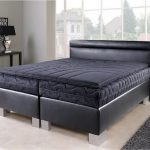 Black Spring Box Black Mattress Black Mattress Pad Black Leather Headboard Black Painted Wood Table With Black Table Lamp And Some Decorative Items In Black Color Grey Shag Bedroom Rug
