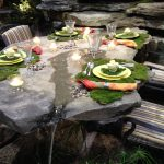 Cool Design Of Stone Patio Tables With Accessoires Of Plates And Glasses On It