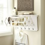 Corday-wood-Accordion-Drying-rack-with-architectural-detail-and-sturdy-rungs-also-antique brass-hooks-and-features-crafted-solid-pine-and-water-resistant-paint