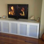 Corner white TV stand with under cabinet by IKEA
