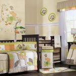 Cute safari toddlers' bedroom decor idea black painted wooden crib with safari themed quilt