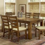 Dark Real Wood Dining Table With Chairs And Decorative Rug