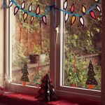 Decoration Of Christmas For Windows With Leaves And Small Christmas Tree On Red Carpet