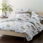 Duvet Covers Of Bed With White Winter Deer Theme On Pillows And Bedcover