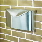 Envelope shaped glossy metalbox mail mounted on wall