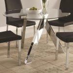 Glass Round Dining Table On Top With Metal Legs And Black Chairs
