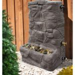 Granite-rain-barrel-fountain-for-catching-rain-and-recycling-through-a-fountain-as-a-functional-attractive-and-eco-friendly-design-sold-by-Julie-Casey