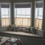 Grey Bay Window Seating With Half Window Curtains
