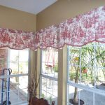 Half Red Toile Curtains On White Window Frame