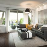 Hardwood Living Room With Dark Wood Floors With Grey Sectional Sofa And Floor Lamp