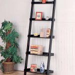 Home Office Black Leaning Ladder Bookshelf On Wooden White Wall