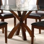 Interior Furniture Of Round Dining Table With Glass On Top Surface And Black Four Chairs
