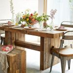 Large wooden dining table by Emmerson with some units wood metal dining chairs a wooden bench