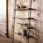 Leaning ladder shelves made from metal and wood