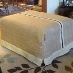 Light brown slipcover with white line at the bottom for an ottoman furniture