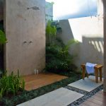 Minimalist Outdoor Shower Idea With Wall Mounted Showerhead Fixture Wooden Planks Shower Floor Small Wood Bench