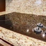 Modern stove with flat shiny surface. Close up view. Kitchen app