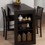 Narrow rectangular wood pub table in black tone color with side open shelves a pair of black coated wood chairs