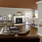Open Space Of Living Room And Dining Room With Grey Interior Paint Color 2014 Wooden Furniture And White Fireplace