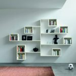 Perfect White Wooden Wall Shelves For Books Near Red Rug