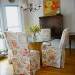 Pretty Floral Parson Chair Slipcovers Design With Round Glass Table On Top Wooden Cabinet And White Chandelier