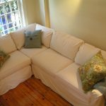 Pure white slipcover for corner sectional sofa three accent pillows in different color
