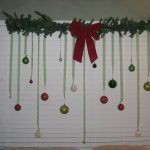 Red Ribbons And Green Decoration For Christmas On Window Closed By White Shader