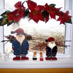 Santa And Plants Decoration On Window With White Frame For Christmas